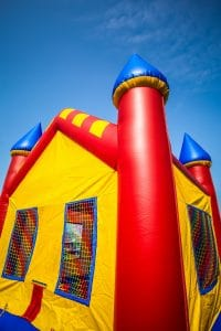 Bounce House Blown onto Highway with Child Inside